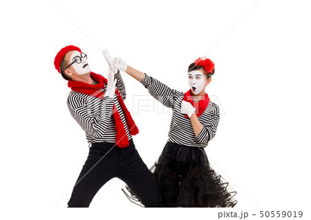 Smiling mimes in striped shirts. 50559019