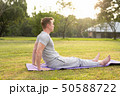 Profile view of young handsome man doing yoga at the park 50588722