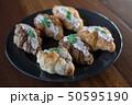 Croissant with Tuna Salad  Sandwich on wood table 50595190