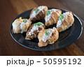 Croissant with Tuna Salad  Sandwich on wood table 50595192