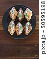 Croissant with Tuna Salad  Sandwich on wood table 50595198