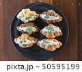 Croissant with Tuna Salad  Sandwich on wood table 50595199
