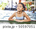 Happy Little Asian Girl At The Pool 50597051