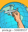 plane in hand. metaphor of flying to America 50609537