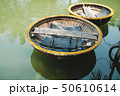 Traditional Round Basket Boat at the Pier 50610614