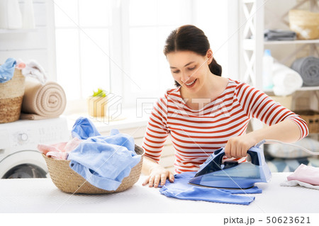 woman is ironing at home 50623621