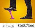 Violet bubble gum stuck to businessman shoes on yellow background 50637300