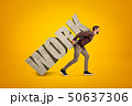 Young man in casual clothes carrying heavy WORK sign on his back on yellow background 50637306