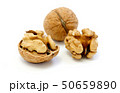 Walnuts, whole and opened on white background 50659890