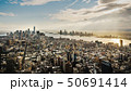 Epic view of Manhattan on the background of a dramatic sky with the rays of the sun 50691414