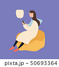 Beautiful caucasian woman sitting on a puff chair using smartphone, vector illustration on blue 50693364