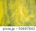 Yellow acrylic clouds swirling under water 50697642