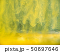 Yellow acrylic ink dropped into water, abstract 50697646