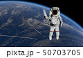 Astronaut Spacewalk, waving his hand in the open 50703705