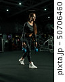 Slim woman in sportswear training view 50706460