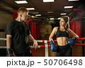 Yuong couple in boxing ring shot 50706498