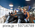 Young beautiful couple on simulators in a gym 50716789