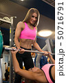 Beautiful fitness trainer in sports gym view 50716791