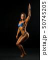 Happy fitness model full-length shot 50745205