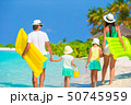Happy beautiful family on white beach with air mattresses  50745959