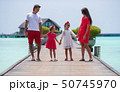 Beautiful family have fun on wooden jetty during summer vacation  50745970