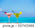 Two tasty cocktails on tropical white beach 50745988