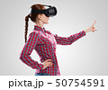 Girl in mask experiencing virtual reality as new entertainment device 50754591