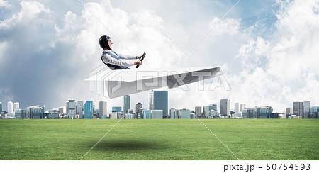 Happy aviator driving paper plane 50754593