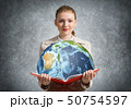 Woman showing earth globe in open book. 50754597