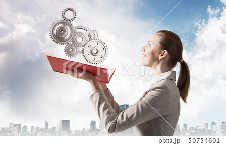 Woman holding open notebook with mechanism 50754601