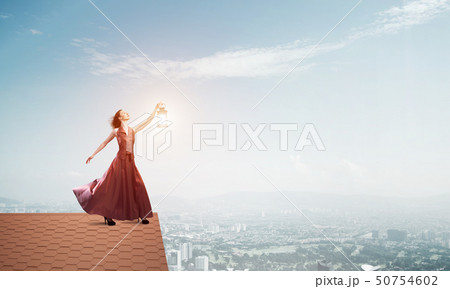 Attractive girl muse with old lantern in hand at summer day. Mixed media 50754602