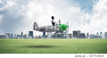 Businessman in aviator hat and goggles 50754605