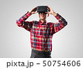 Guy in mask experiencing virtual reality as new entertainment device 50754606
