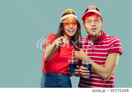 Beautiful couple isolated on blue studio background 50770268