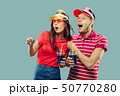 Beautiful couple isolated on blue studio background 50770280