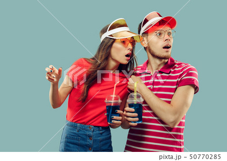 Beautiful couple isolated on blue studio background 50770285