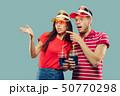 Beautiful couple isolated on blue studio background 50770298