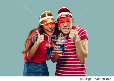 Beautiful couple isolated on blue studio background 50770302