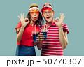 Beautiful couple isolated on blue studio background 50770307