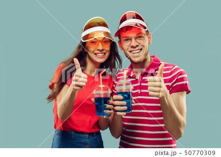 Beautiful couple isolated on blue studio background 50770309
