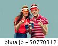 Beautiful couple isolated on blue studio background 50770312