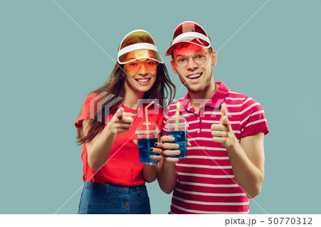 Beautiful couple isolated on blue studio background 50770312