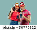 Beautiful couple isolated on blue studio background 50770322