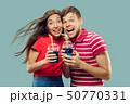 Beautiful couple isolated on blue studio background 50770331