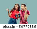 Beautiful couple isolated on blue studio background 50770336