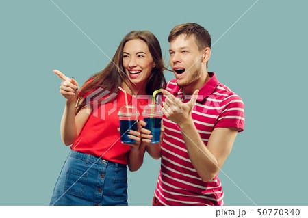 Beautiful couple isolated on blue studio background 50770340