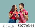 Beautiful couple isolated on blue studio background 50770344