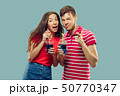 Beautiful couple isolated on blue studio background 50770347