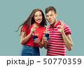 Beautiful couple isolated on blue studio background 50770359