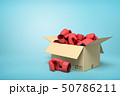 3d rendering of cardboard box full of red boxing gloves on blue background. 50786211